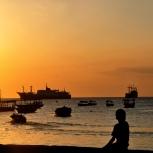 Children overlook the Indian Ocean at sunset in Stone Town, Zanzibar.